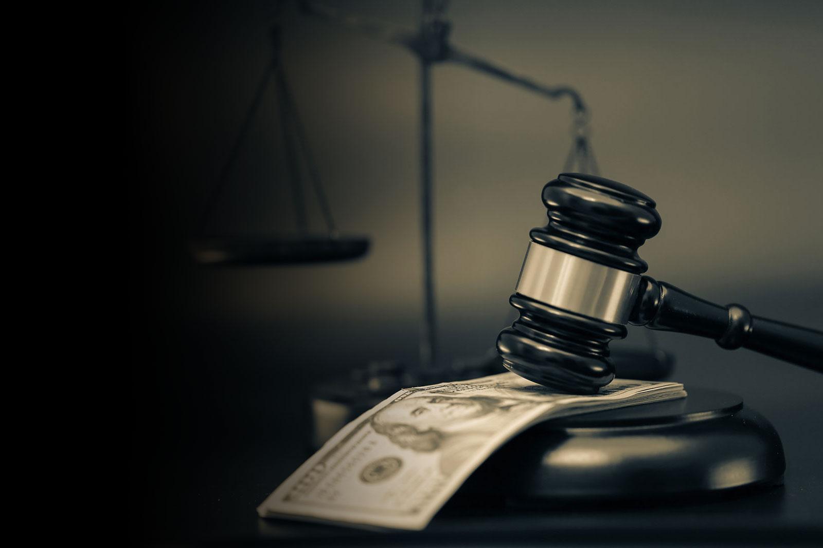 Home Header Background - Judge Mallet Hitting Stack of Hundred Dollar Bills