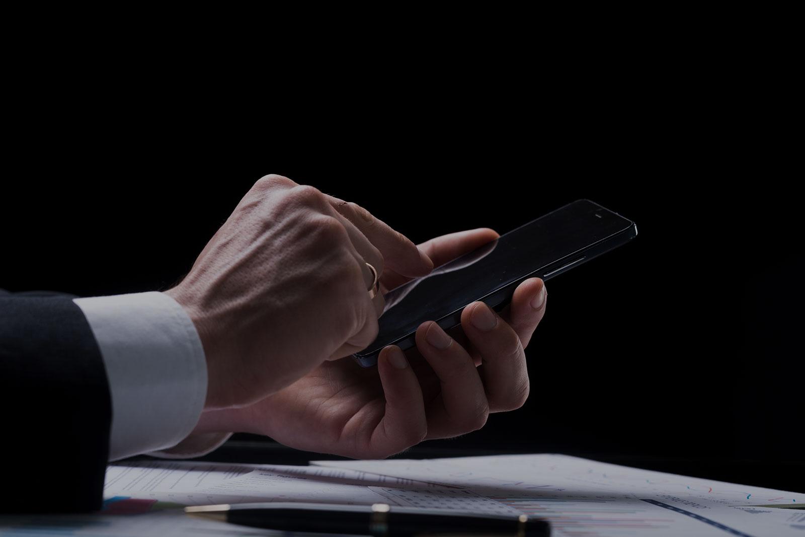 Contact Header Background - Businessman Using Smart Phone