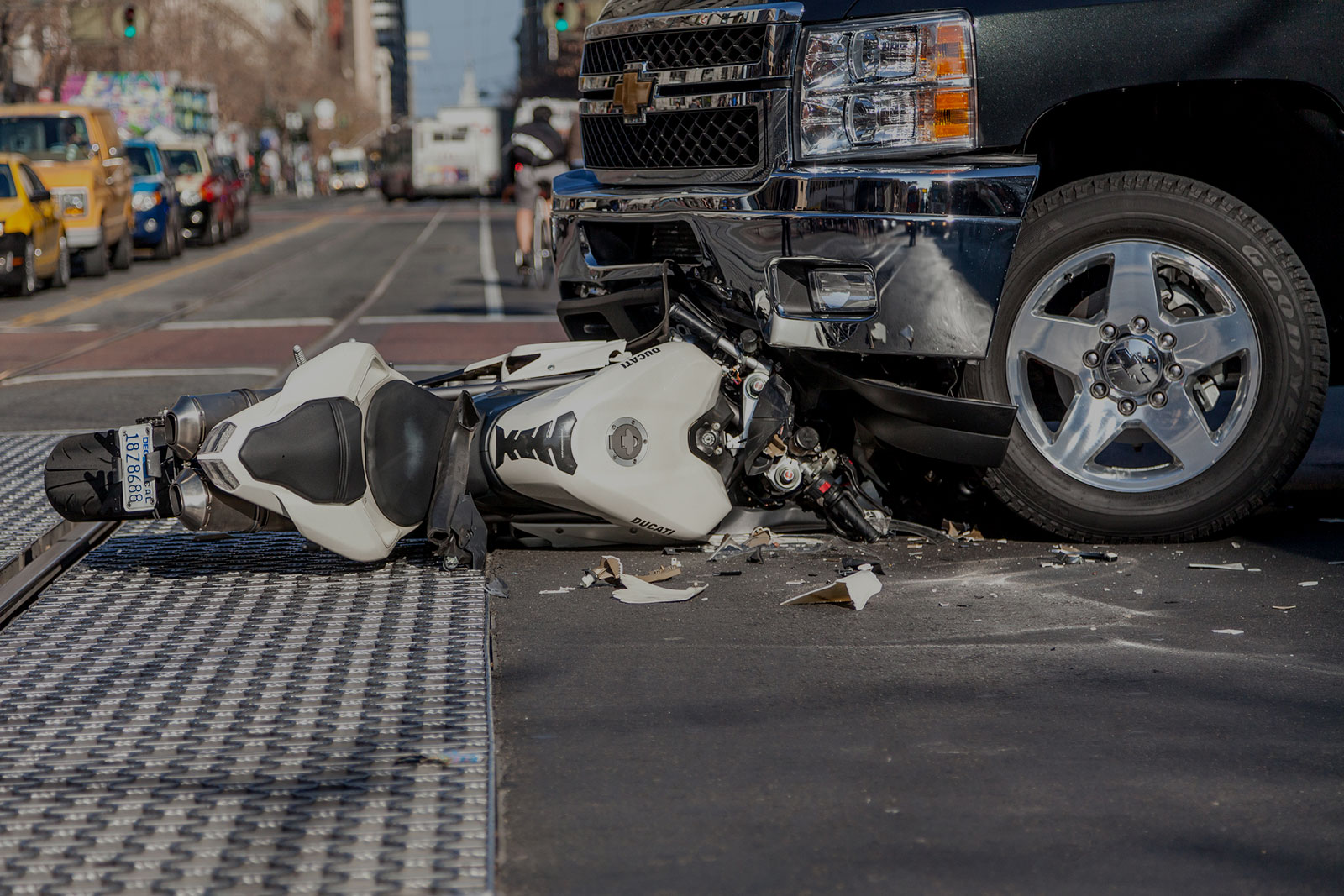 Personal Injury Header Background - Crashed Motorcycle Beneath Chevy Car